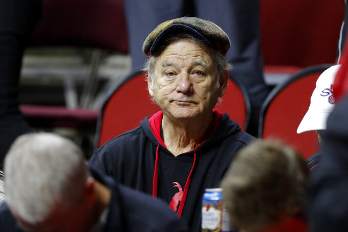 Actor Bill Murray sits in the stands before a first round men's college basketball game between Minnesota and Louisville in the NCAA Tournament, Thursday, March 21, 2019, in Des Moines, Iowa. (AP Photo/Charlie Neibergall)