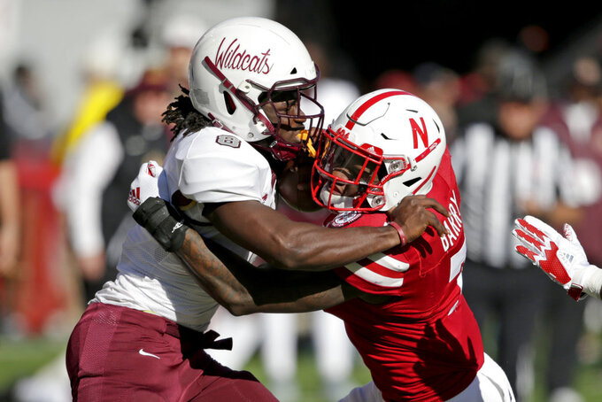 Bethune-Cookman running back Tupac Isme (8) is tackled by Nebraska linebacker Mohamed Barry (7) during the first half of an NCAA college football game in Lincoln, Neb., Saturday, Oct. 27, 2018. (AP Photo/Nati Harnik)