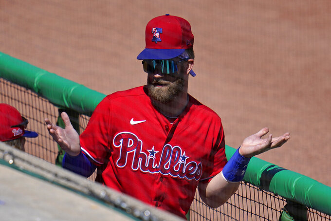 Philadelphia Phillies' Bryce Harper gestures in the dugout during a spring training exhibition baseball game against the Detroit Tigers in Clearwater, Fla., Wednesday, March 10, 2021. Harper was designated hitter for the game and went 0-3. (AP Photo/Gene J. Puskar)