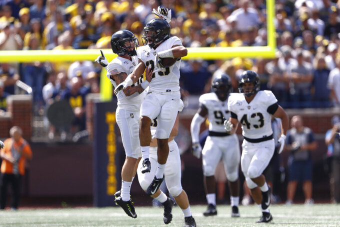 Army defensive back Elijah Riley (23) celebrates a Michigan quarterback Shea Patterson (2) fumble in the first half of an NCAA college football game in Ann Arbor, Mich., Saturday, Sept. 7, 2019. (AP Photo/Paul Sancya)