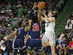 Marshall's Marko Sarenac (15) shoots over Robert Morris defenders Jon Williams (1) and Charles Bain (20) during an NCAA college basketball game Thursday, Nov. 7, 2019, in Huntington, W.Va. (Sholten Singer/The Herald-Dispatch via AP)