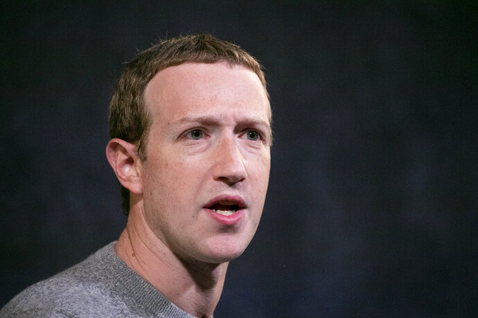 """In this Oct. 25, 2019 photo Facebook CEO Mark Zuckerberg speaks at the Paley Center in New York. Facebook employees are using Twitter to register their frustration over Zuckerberg's decision to leave up posts by President Donald Trump that suggested protesters in Minneapolis could be shot. On Monday, June 1, 2020 Facebook employees staged a virtual """"walkout"""" to protest the company's decision not to touch the Trump posts according to a report in the New York Times, which cited anonymous senior employees at Facebook. (AP Photo/Mark Lennihan)"""
