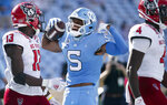 North Carolina's Dazz Newsome (5) celebrates in front of N.C. State's Tyler Baker-Williams (13) after a nine-yard gain in the third quarter of an NCAA college football game on Saturday, Oct. 24, 2020, in Chapel Hill, N.C. (Robert Willett/The News & Observer via AP)