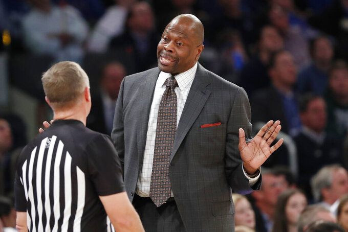 Georgetown coach Patrick Ewing objects to a call as he talks to an official during the first half of the team's NCAA college basketball game against Duke in the 2K Empire Classic, Friday, Nov. 22, 2019 in New York. (AP Photo/Kathy Willens)