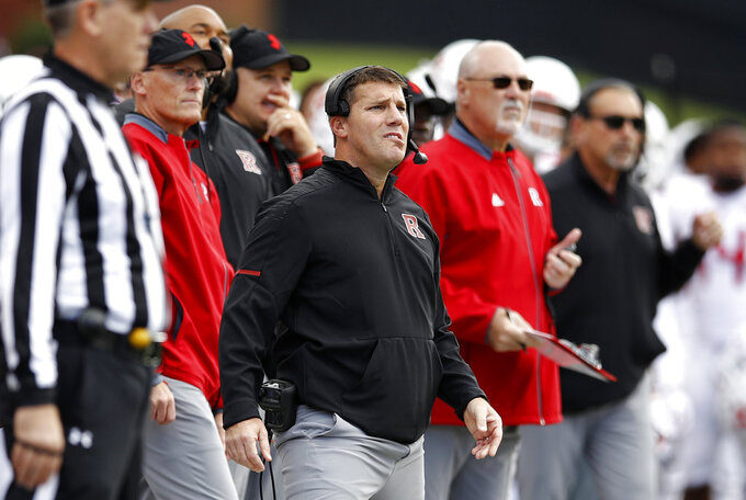 Rutgers head coach Chris Ash, center, reacts as he watches a successful Maryland field goal attempt in the first half of an NCAA college football game, Saturday, Oct. 13, 2018, in College Park, Md. Maryland won 34-7. (AP Photo/Patrick Semansky)