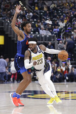 Indiana Pacers' Wesley Matthews (23) goes to the basket against Oklahoma City Thunder's Terrance Ferguson (23) during the second half of an NBA basketball game, Thursday, March 14, 2019, in Indianapolis. Indiana won 108-106. (AP Photo/Darron Cummings)
