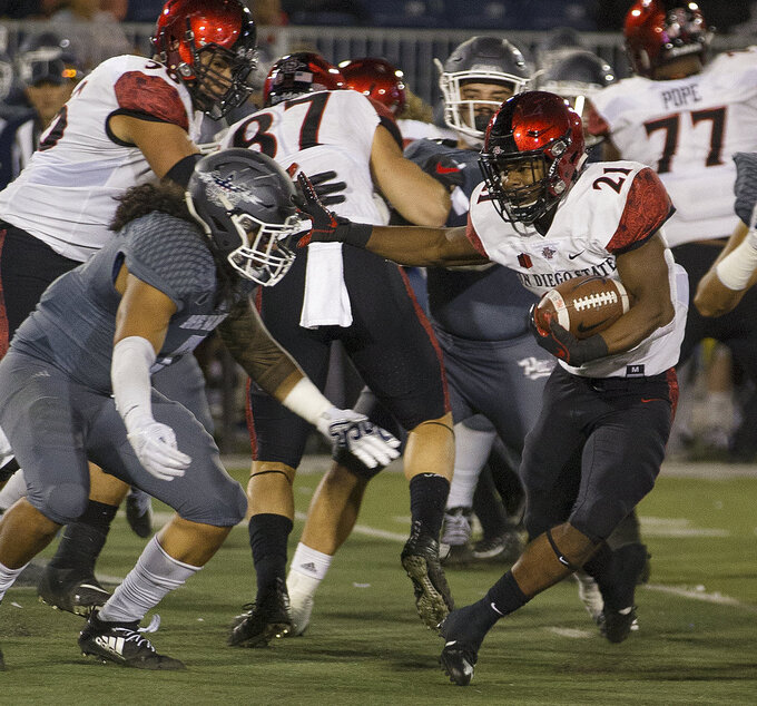 San Diego State running back Chance Bell (21) runs against Nevada in the first half of an NCAA college football game in Reno, Nev., Saturday, Oct. 27, 2018. (AP Photo/Tom R. Smedes)