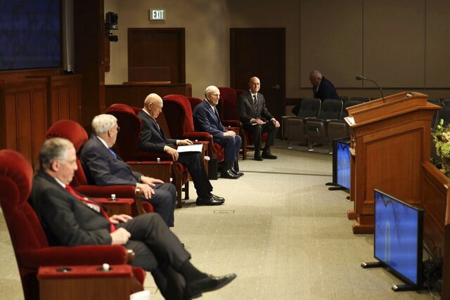 In this photograph provided by The Church of Jesus Christ of Latter-day Saints shows, left to right, Neil L. Andersen, M. Russell Ballard, both members of a top governing board called the Quorum of the Twelve Apostles, counselor, Dallin H. Oaks, President Russell M. Nelson and counselor Henry B. Eyring during The Church of Jesus Christ of Latter-day Saints' twice-annual church conference Saturday, April 4, 2020, in Salt Lake City. The conference kicked off Saturday without anyone attending in person and top leaders sitting some 6 feet apart inside an empty room as the faith takes precautions to avoid the spread of the coronavirus. A livestream of the conference showed a few of the faith's top leaders sitting alone inside a small auditorium in Salt Lake City, Normally, top leaders sit side-by-side on stage with the religion's well-known choir behind them and some 20,000 people watching. (The Church of Jesus Christ of Latter-day Saints via AP)