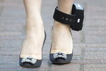 Meng Wanzhou chief financial officer of Huawei wears an ankle monitor as she leaves her home to go to B.C. Supreme Court in Vancouver, Tuesday, January 21, 2020. Wanzhou is in court for hearings over an American request to extradite the executive of the Chinese telecom giant Huawei on fraud charges. (Jonathan Hayward/The Canadian Press via AP)