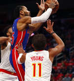 Detroit Pistons guard Derrick Rose makes a layup as Atlanta Hawks guard Trae Young (11) defends during the first half of an NBA basketball game Thursday, Oct. 24, 2019, in Detroit. (AP Photo/Carlos Osorio)