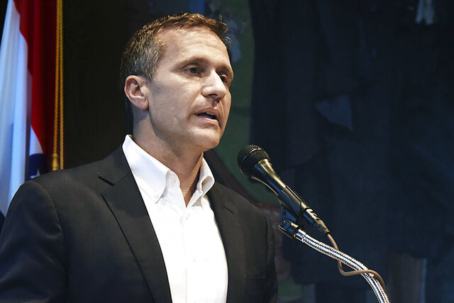 FILE - In this May 29, 2018, file photo, Missouri Gov. Eric Greitens announces his resignation during a news conference in Jefferson City. An ethics investigation has found that Greitens' campaign cooperated with a political action committee during his successful bid for governor. Missouri Ethics Commission findings released on Thursday, Feb. 13, 2020, say there's