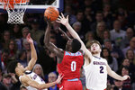Loyola Marymount guard Eli Scott, center, shoots between Gonzaga guard Ryan Woolridge, left, and forward Drew Timme during the first half of an NCAA college basketball game in Spokane, Wash., Thursday, Feb. 6, 2020. (AP Photo/Young Kwak)