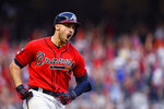 Atlanta Braves Adam Duvall (23) runs the bases after hitting a two-run homer against the St. Louis Cardinals in the seventh inning during Game 2 of a best-of-five National League Division Series, Friday, Oct. 4, 2019, in Atlanta. (AP Photo/John Amis)