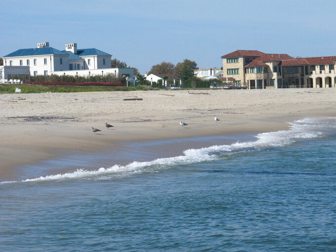This Sept. 27, 2021, photo shows the oceanfront in Deal, N.J. Deal is one of three Jersey Shore towns that will share a $26 million beach replenishment project starting in November. (AP Photo/Wayne Parry)