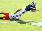 BYU quarterback Zach Wilson (1) dives in for a touchdown ahead of UTSA linebacker Jamal Ligon (88) during an NCAA college football game in Provo, Utah, Saturday, Oct. 10, 2020. (Spenser Heaps/The Deseret News via AP)