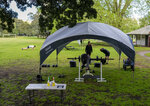 People workout in a park in the eastern suburbs of Sydney Tuesday, Sept. 14, 2021. Personal trainers have turned a waterfront park at Sydney's Rushcutters Bay into an outdoor gym to get around pandemic lockdown restrictions. (AP Photo/Mark Baker)