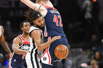 San Antonio Spurs guard Patty Mills, left, tries to get past Washington Wizards forward Davis Bertans (42) during the first half of an NBA basketball game, Wednesday, Nov. 20, 2019, in Washington. (AP Photo/Nick Wass)