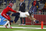 Nevada wide receiver Elijah Cooks dives in for a touchdown as Fresno State defensive back Wylan Free tries to stop Cooks before the line during the first half of an NCAA college football game in Fresno, Calif., Saturday, Nov. 23, 2019. (AP Photo/Gary Kazanjian)