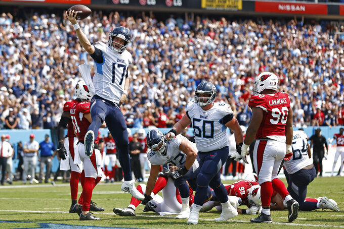 Tennessee Titans quarterback Ryan Tannehill (17) celebrates after scoring a touchdown against the Arizona Cardinals in the first half of an NFL football game Sunday, Sept. 12, 2021, in Nashville, Tenn. (AP Photo/Wade Payne)