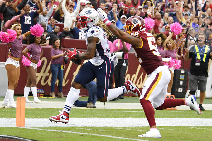 New England Patriots running back Brandon Bolden (38) runs into the end zone for a touchdown against Washington Redskins linebacker Ryan Anderson (52) during the second half of an NFL football game, Sunday, Oct. 6, 2019, in Washington. (AP Photo/Nick Wass)