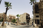 A person walks through the Jiddah's historical district, a UNESCO registered world heritage site, which is empty due to coronavirus restrictions, in Jiddah, Saudi Arabia, Monday, June 15, 2020. This was supposed to be Saudi Arabia's year to shine as host of the prestigious G20 gathering of world leaders. Instead, due to the pandemic, the gathering this November will likely be a virtual meet-up. The impact of the coronavirus and low oil prices have forced a recalibration of Prince Mohammed bin Salman's ambitious plans to revamp Saudi society and its oil-dependent economy.  (AP Photo/Amr Nabil)