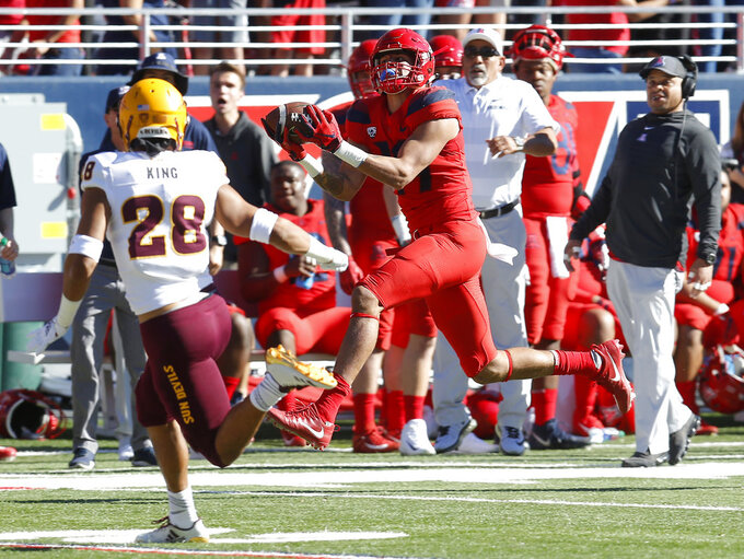 Arizona wide receiver Shawn Poindexter makes a catch for a first down in front of Arizona State defensive back Demonte King (28) in the first half during an NCAA college football game, Saturday, Nov. 24, 2018, in Tucson, Ariz. (AP Photo/Rick Scuteri)