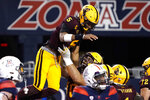 Arizona State quarterback Jayden Daniels (5) celebrates with Henry Hattis after scoring a touchdown against Arizona during the first half of an NCAA college football game Friday, Dec. 11, 2020, in Tucson, Ariz. (AP Photo/Rick Scuteri)