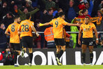 Wolverhampton Wanderers' Raul Jimenez celebrates scoring his side's third goal with teammates of the game during the English Premier League soccer match between Southampton and Wolverhampton Wanderers at the St Mary's stadium, Southampton, England. Saturday, Jan. 18, 2020. (Mark Kerton/PA via AP)