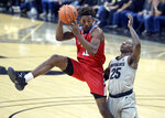 Loyola Marymount forward Parker Dortch, left, pulls in a rebound as Colorado guard McKinley Wright IV defends the first half of an NCAA college basketball game Wednesday, Dec. 4, 2019, in Boulder, Colo. (AP Photo/Cliff Grassmick)