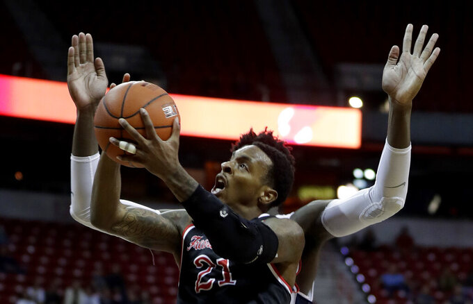 Fresno State's Deshon Taylor shoots during the second half of the team's NCAA college basketball game against Utah State in the Mountain West Conference men's tournament Friday, March 15, 2019, in Las Vegas. (AP Photo/Isaac Brekken)
