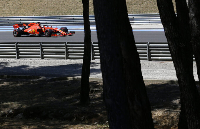 Ferrari driver Sebastian Vettel of Germany steers his car during the qualifying session at the Paul Ricard racetrack in Le Castellet, southern France, Saturday, June 22, 2019. The French Formula One Grand Prix will be held on Sunday. (AP Photo/Claude Paris)