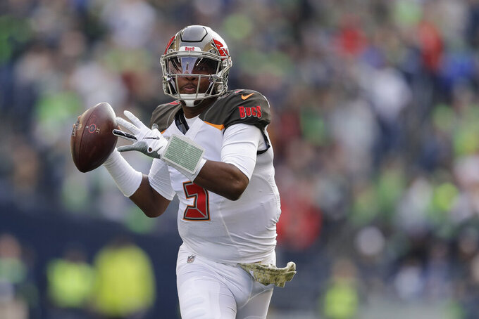 Tampa Bay Buccaneers quarterback Jameis Winston looks to pass against the Seattle Seahawks during the first half of an NFL football game, Sunday, Nov. 3, 2019, in Seattle. (AP Photo/John Froschauer)