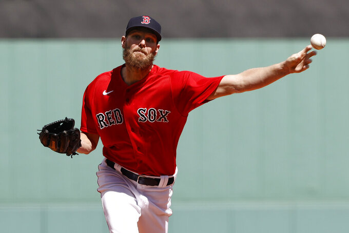 Boston Red Sox starting pitcher Chris Sale delivers against the Tampa Bay Rays during the first inning of a baseball game Monday, Sept. 6, 2021, at Fenway Park in Boston. (AP Photo/Winslow Townson)
