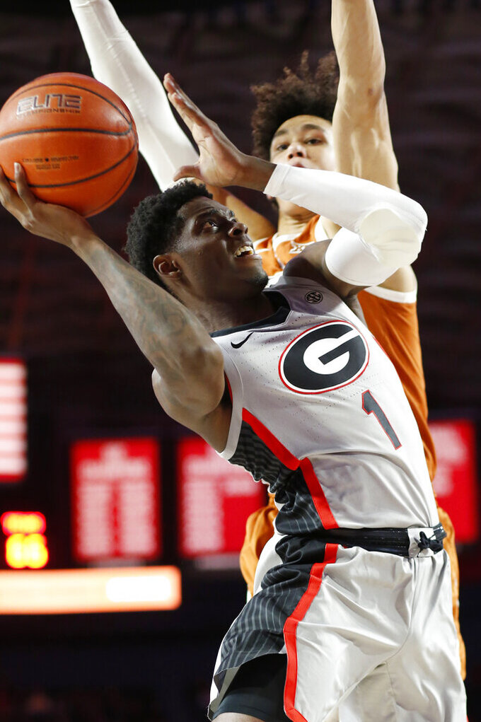 Georgia guard Teshaun Hightower (1) takes a shot past Texas forward Jaxson Hayes (10) during an NCAA college basketball game in Athens, Ga., Saturday, Jan. 26, 2019. (Joshua L. Jones/Athens Banner-Herald via AP)