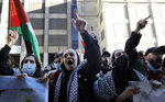Hundreds of protesters gather in support of Palestinians in front of the Consulate General of Israel on Wednesday, May 12, 2021 in Chicago. (AP Photo/Shafkat Anowar)