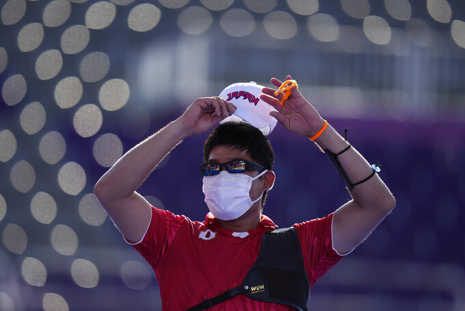 Third placed Japan's Takaharu Furukawa celebrates after beating Taiwan's Tang Chih-Chun in the bronze medal match of the men's individuals at the 2020 Summer Olympics, Saturday, July 31, 2021, in Tokyo, Japan. (AP Photo/Alessandra Tarantino)