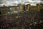 People gather at Plaza del Castillo square during the International Women's Day in Pamplona, northern Spain, Friday, March 8, 2019. Spanish women are marking International Women's Day with a full day strike and dozens of protests across the country against wage gap and gender violence. (Alvaro Barrientos)