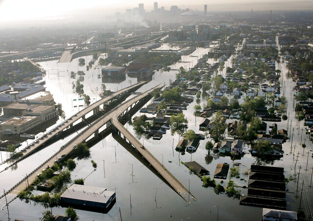 FILE - In this Aug. 30, 2005, file photo, floodwaters from Hurricane Katrina fill the streets near downtown New Orleans. Two New Orleans universities, the Roman Catholic Archdiocese of New Orleans and a government contractor are defendants in a whistleblower lawsuit alleging fraud involving more than $100 million in Hurricane Katrina aid. (AP Photo/David J. Phillip, File)