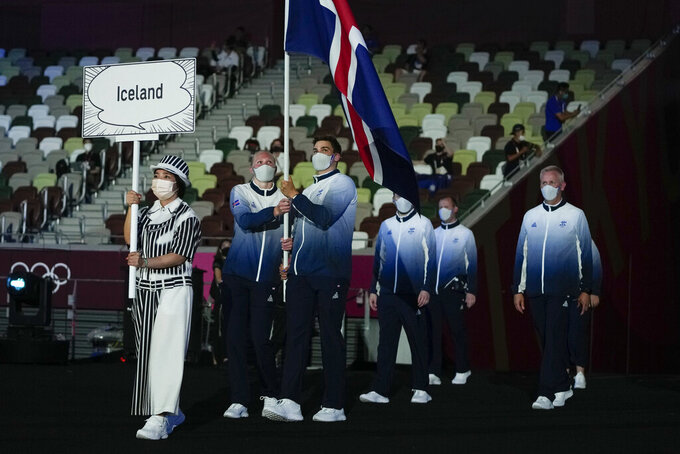Snaefridur Sol Jorunnardottir and Anton Mckee, of Iceland, carry their country's flag during the opening ceremony in the Olympic Stadium at the 2020 Summer Olympics, Friday, July 23, 2021, in Tokyo, Japan. (AP Photo/Natacha Pisarenko)