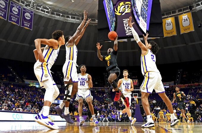 Maryland-Baltimore County guard Darnell Rogers (2) drives to the basket through heavy traffic in the second half of the team's NCAA college basketball game against LSU, Tuesday, Nov. 19, 2019, in Baton Rouge, La. LSU won 77-50. (AP Photo/Bill Feig)