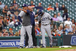 Tampa Bay Rays manager Kevin Cash, from left, signals for a pinch runner as team trainer Joe Benge helps Wander Franco to the dugout from third base against the Detroit Tigers in the first inning of a baseball game in Detroit, Friday, Sept. 10, 2021. (AP Photo/Paul Sancya)