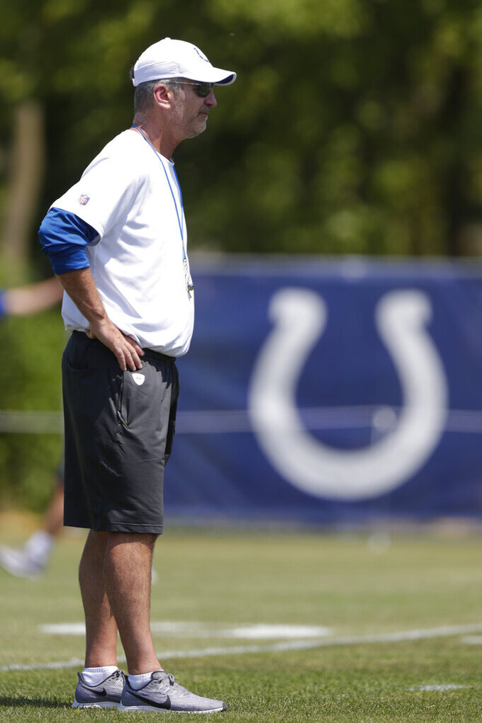 Indianapolis Colts head coach Frank Reich watch his team during practice at the NFL team's football training camp in Westfield, Ind., Thursday, July 25, 2019. (AP Photo/Michael Conroy)