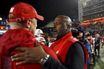 Nebraska head coach Scott Frost, left, and Maryland head coach Mike Locksley shake hands after Nebraska defeated Maryland in an NCAA college football game, Saturday, Nov. 23, 2019, in College Park, Md. (AP Photo/Will Newton)