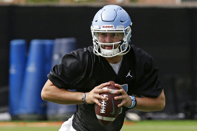 FILE - In this Aug. 2, 2019, file photo, North Carolina quarterback Sam Howell (7) is shown during an NCAA college football practice in Chapel Hill, N.C. North Carolina is starting true freshman Sam Howell at quarterback for Saturday's opener against South Carolina in Charlotte. (AP Photo/Gerry Broome, File)