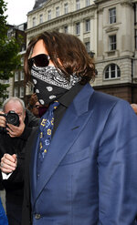 """Johnny Depp arrives at the High Court in London, Thursday, July 9, 2020. Johnny Depp is back in the witness box for a third day at the trial of his libel suit against a tabloid newspaper that called him a """"wife-beater."""" Depp is suing News Group Newspapers, publisher of The Sun, and the paper's executive editor, Dan Wootton, over an April 2018 article that said he'd physically abused ex-wife Amber Heard.  He strongly denies ever hitting Heard. (AP Photo/Alberto Pezzali)"""