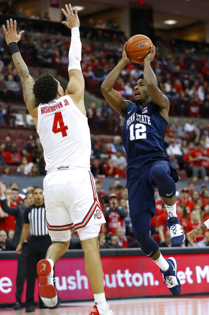 Penn State's Izaiah Brockington, right, shoots over Ohio State's Duane Washington during the first half of an NCAA college basketball game Saturday, Dec. 7, 2019, in Columbus, Ohio. (AP Photo/Jay LaPrete)