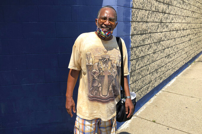 Victor Gibson poses for a photo July 9, 2020, in Detroit. Despite fears that the coronavirus pandemic will worsen, Gibson said he's not planning to take advantage of Michigan's expanded vote-by-mail system when he casts his ballot in November. The retired teacher from Detroit just isn't sure he can trust it. Many Black voters across the U.S. share similar concerns and are planning to vote in person on Election Day, even as voting by mail expands to more states as a safety precaution during the pandemic. (AP Photo/Corey Williams)
