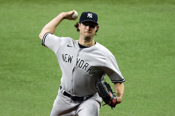 New York Yankees' Gerrit Cole pitches to the Tampa Bay Rays during the first inning of the first game of a baseball doubleheader game Saturday, Aug. 8, 2020, in St. Petersburg, Fla. (AP Photo/Chris O'Meara)