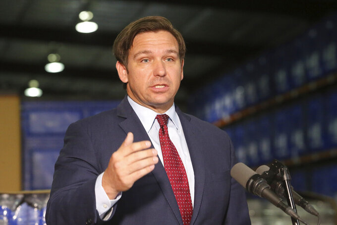 Florida Gov. Ron DeSantis answers questions at a news conference at an emergency management warehouse about the spread of the coronavirus, Friday March 13, 2020 in Tallahassee, Fla. The vast majority of people recover from the new coronavirus. According to the World Health Organization, most people recover in about two to six weeks, depending on the severity of the illness. (AP Photo/Steve Cannon)