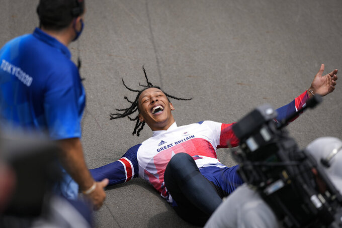 Kye Whyte of Britain lays on the track after winning the silver medal in the men's BMX Racing finals at the 2020 Summer Olympics, Friday, July 30, 2021, in Tokyo, Japan. (AP Photo/Ben Curtis)